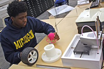 CAD student examines 3D printing project