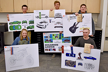 CAD students holding their projects for competition.